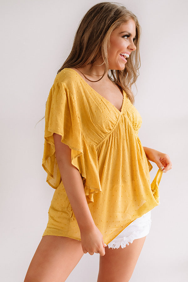 Ahead Of The Curve Babydoll Top In Marigold