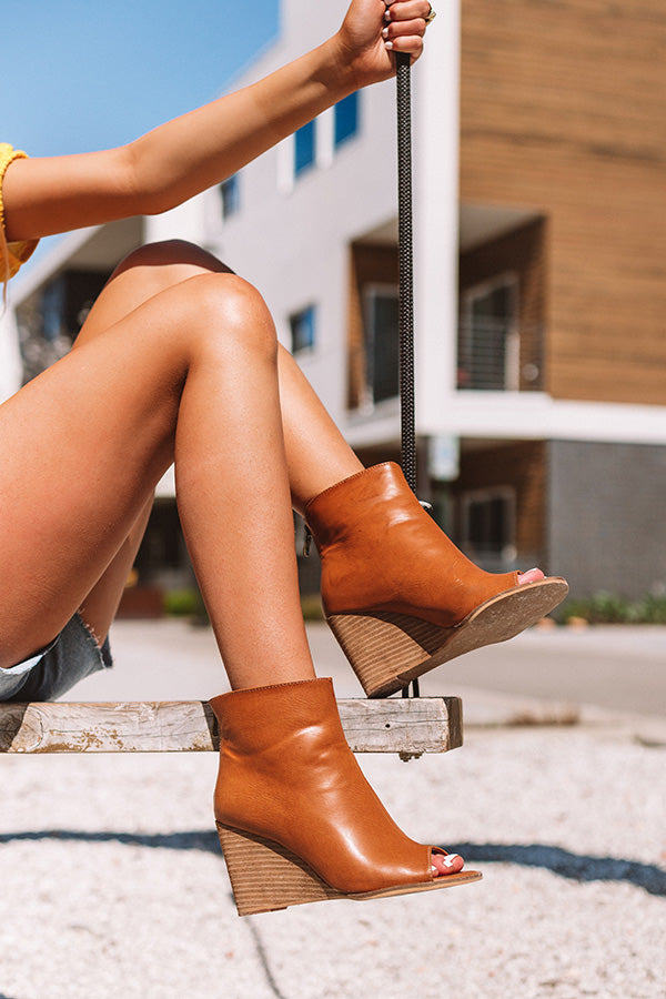 The Portia Faux Leather Peep Toe Bootie In Camel