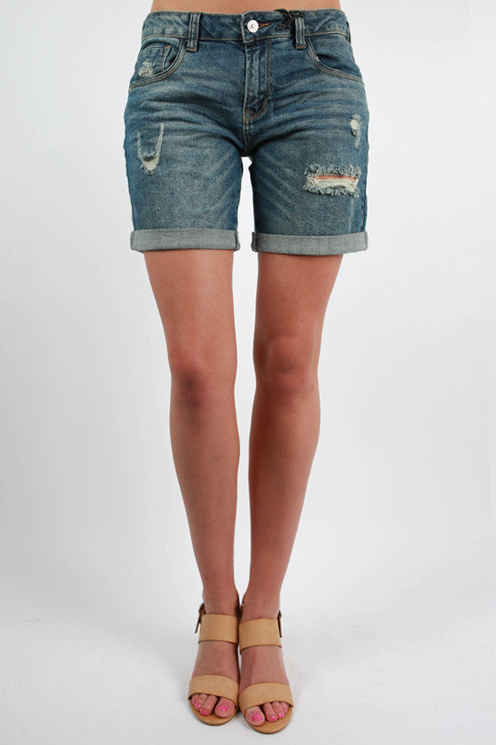 Mid Length Distressed Shorts in Medium Blue
