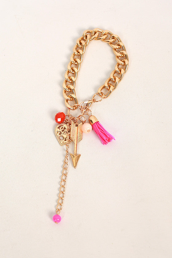 Lively Charms & Tassel Bracelet in Fuchsia