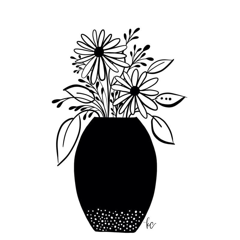 pretty black and white flowers in a vase