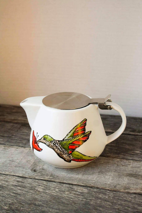 Teapot with hummingbird design infuser