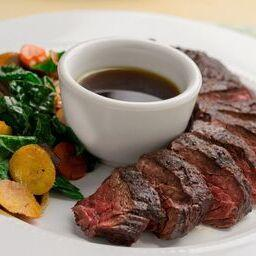 Hangar Steak in Roasted Garlic Au Jus served with Organic Vegetables