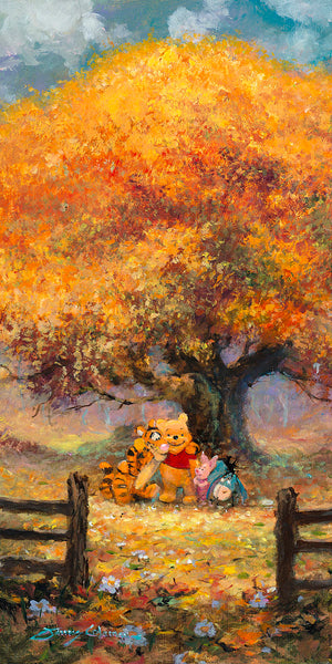 Winnie the Pooh, and friends pose in front of tree filled with autumn colors.