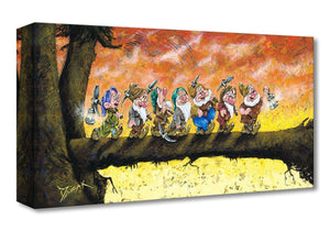 Seven Dwarfs are walking across a fallen the tree log leading to the path home.