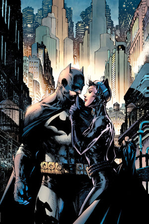 Catwoman has Batman attention as she cuddles right up to him.