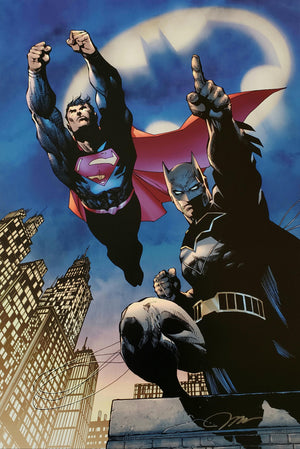 The familiar shape illuminates the sky above city, being the caped crusader's Batman and Superman together again.