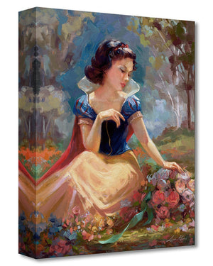 The beautiful Snow White sitting in the garden, gathering a bouquet of flowers.