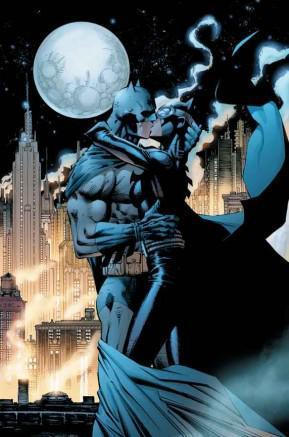 Batman and Catwoman embraced in a kiss, Gotham City and a full moon in the background.