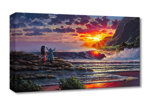 Lilo and Stitch standing at the rocky shoreline watching the sun brighten the sky as it begins to fall into the horizon.