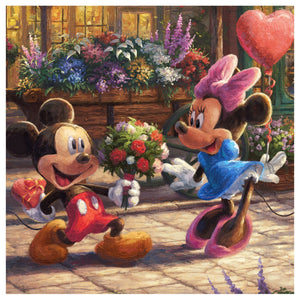 Mickey presents Minnie with a bouquet of flowers and a heart shpaed chocolate - closeup