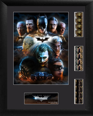 "The Dark Knight Trilogy (Character Collage) ""It's not who I am underneath, but what I do that defines me."" Relive Christopher Nolan's Dark Knight trilogy with this limited edition FilmCells™ presentation that features a collage image of the trilogy's heroes and villains, a certificate of authenticity, and three strips of real 35mm film from the movies. Size 14"" x 18"" Black MDF Frame"