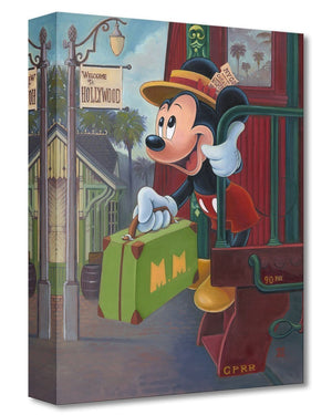 Mickey getting off the train, holding his suitcase as he arrives in Hollywood train station.