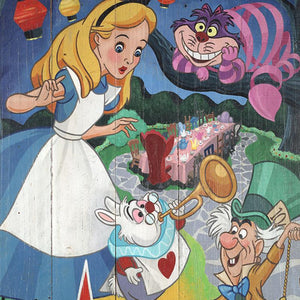Alice meets the Mad Hatter, Cheshire Cat, and White Rabbit at ALICE - AU PAYS DES MERVEILLES, tea party - closeup.