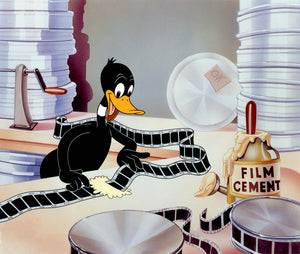 Daffy seen splicing together the movies film in the prodction room..