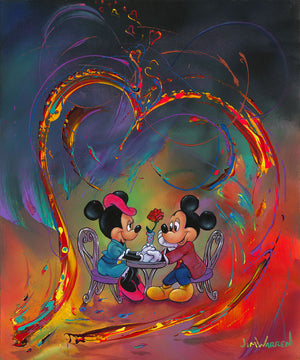 Mickey and Minnie sharing a romantic moment as they sit at a bristo table holding hands.