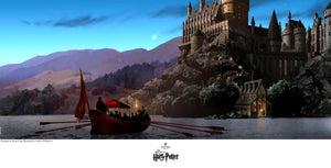 Students headed to Hogwarts castle by boat.