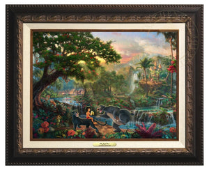 Jungle Book by Thomas Kinkade Studios.  Mowgli  the man-cub sits on the back of Bagheera while eating his banana, and watches Baloo play around - Aged Bronze Frame