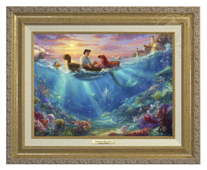Little Mermaid Falling in Love by Thomas Kinkade Studios.  Ariel and Prince Eric share precious time together with Flounder and Sebastian nearby. The wretched sea witch, Ursula, lurks in the shadows for her opportunity to strike. Deep below King Triton races from the castle in Atlantica to rescue his daughter - Antique Gold Frame