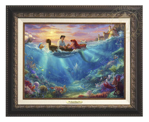 Little Mermaid Falling in Love by Thomas Kinkade Studios.  Ariel and Prince Eric share precious time together with Flounder and Sebastian nearby. The wretched sea witch, Ursula, lurks in the shadows for her opportunity to strike. Deep below King Triton races from the castle in Atlantica to rescue his daughter - Aged Bronze Frame
