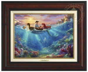 Little Mermaid Falling in Love by Thomas Kinkade Studios.  Ariel and Prince Eric share precious time together with Flounder and Sebastian nearby. The wretched sea witch, Ursula, lurks in the shadows for her opportunity to strike. Deep below King Triton races from the castle in Atlantica to rescue his daughter- Burl Frame