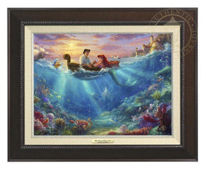 Little Mermaid Falling in Love by Thomas Kinkade Studios.  Ariel and Prince Eric share precious time together with Flounder and Sebastian nearby. The wretched sea witch, Ursula, lurks in the shadows for her opportunity to strike. Deep below King Triton races from the castle in Atlantica to rescue his daughter - Espresso Frame