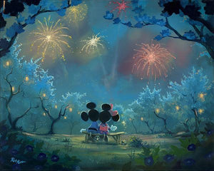 Mickey and Minnie sitting on a bench watching the spectacular firework's celebration lighting-up the night sky.