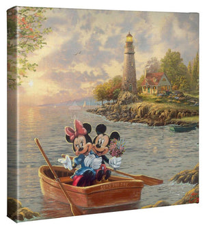 Mickey and Minnie enjoying each other's company as the evening breeze softly blows the waves onto the rocks.