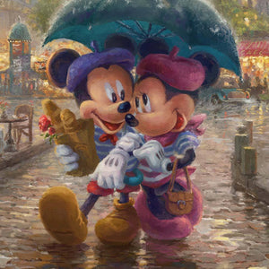 Dressed in traditional French attire, Mickey and Minnie enjoy playing tourist in their berets and striped shirts - closeup