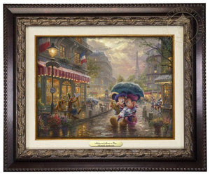 Mickey and Minnie in Paris by Thomas Kinkade Studios.  Dressed in traditional French attire, Mickey and Minnie enjoy playing tourist in their berets and striped shirts after spending the morning at the cafe - aged bronze frame