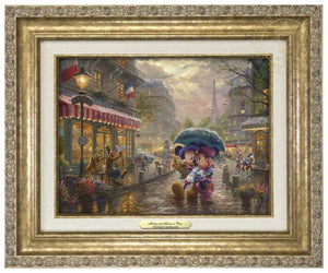 Mickey and Minnie in Paris by Thomas Kinkade Studios.  Dressed in traditional French attire, Mickey and Minnie enjoy playing tourist in their berets and striped shirts after spending the morning at the cafe - antique gold frame