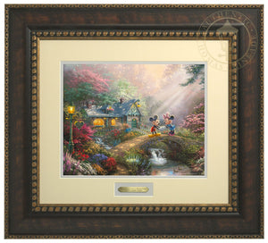 Mickey Mouse and Minnie Mouse join hands on Sweetheart Bridge, surrounded by a flower-filled countryside, love appears to be in the air - Bronzed Gold Frame