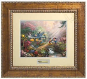 Mickey Mouse and Minnie Mouse join hands on Sweetheart Bridge, surrounded by a flower-filled countryside, love appears to be in the air - Antiqued Gold Frame
