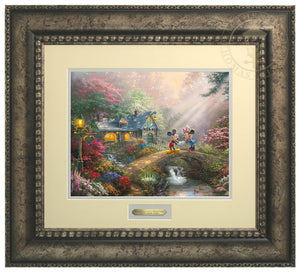 Mickey Mouse and Minnie Mouse join hands on Sweetheart Bridge, surrounded by a flower-filled countryside, love appears to be in the air - Antiqued Silver Frame