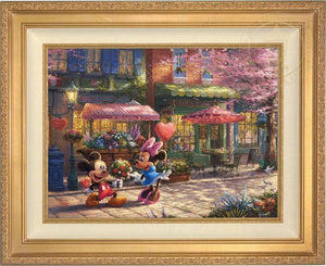 Mickey presents Minnie with a bouquet of flowers and a heart shaped box of chocolate in front of Cafe Bristo - Antique Gold Frame