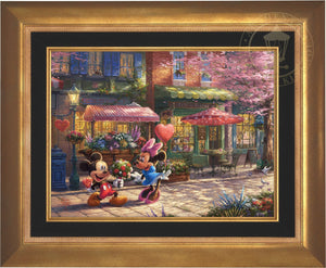 Mickey presents Minnie with a bouquet of flowers and a heart shaped box of chocolate in front of Cafe Bristo - Aurora Gold Frame