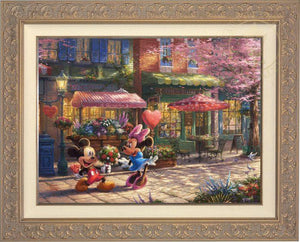 Mickey presents Minnie with a bouquet of flowers and a heart shaped box of chocolate in front of Cafe Bristo - Carrisa Frame
