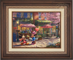 Mickey presents Minnie with a bouquet of flowers and a heart shaped box of chocolate in front of Cafe Bristo - Dark Walnut Frame