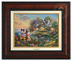 Mickey Mouse and Minnie Mouse stand on the edge of Sweetheart Cove - Burl Frame