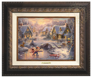 Mickey Mouse and Minnie Mouse joyfully skate across a frozen pond, celebrating the magic of the Holidays together.  Aged Bronze  Frame