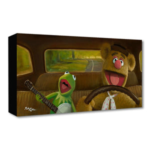 Movin Right Along by Rob Kaz.  Fozzie the bear behind the driver's wheel, singing along with Kermit the Frog has he plays his banjo.