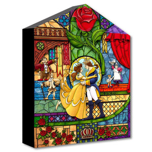 A stain glass mural of of the Beauty and the Prince. and the castle's real characters