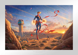 The morning sun dawns on a new day amplifying the glowing power emanating from Captain Marvel's hands as she watches over the desert base.  - Unframed Paper