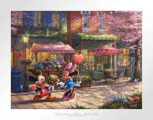 Mickey presents Minnie with a bouquet and a heart-shaped box of chocolate in front of Cafe Bristo.