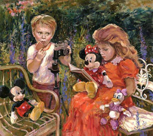 Little red-headed girl and her friend are sitting in the garden, as she reads to her stuffed friends, Minnie, Mickey and Daisy.