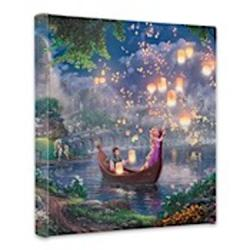 A newly found love - Rapunzel and Flynn as they boat together on her 18th birthday.   Maximus, Pascal and Mother Gothel, are seen on the lake shore. A thousand floating lanterns glow against the starlight of the night sky.