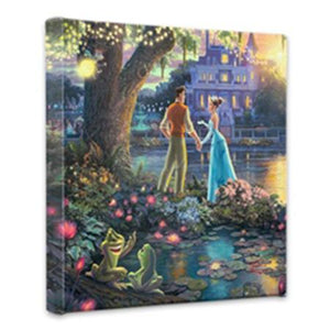 Tiana and the Prince stand by the bayou river edge holding hands under the oak tree, as the two frogs (Tiana and the Prince) watch.
