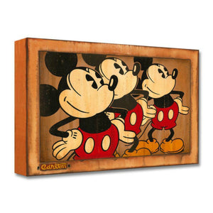 Three Vintage Mickeys by Trevor Carlton  All three Mickeys stand tall with hands resting on the hips.
