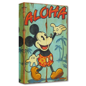 Mickey welcomes the Island's guest with an Aloha wave.
