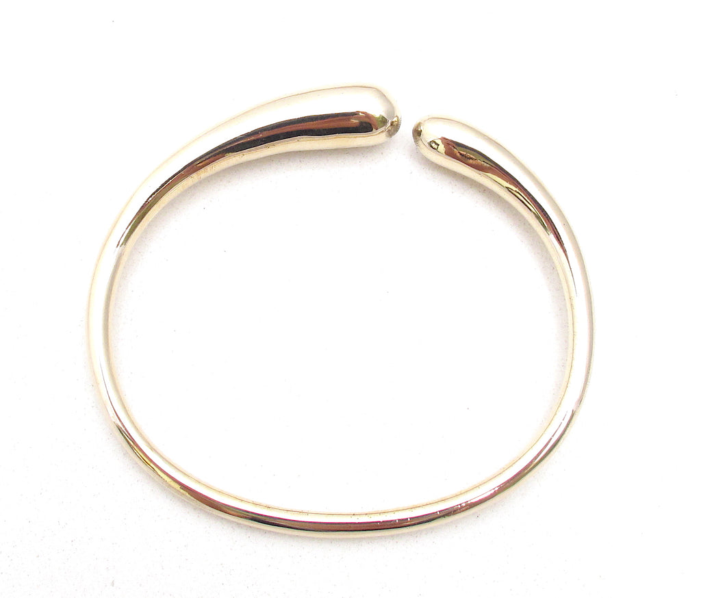 Fluid bangle, bronze +more options